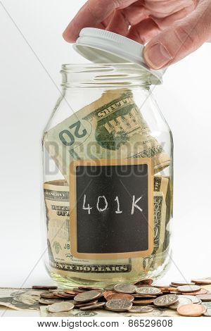 Hand Opening Glass Jar Used For 401K Fund