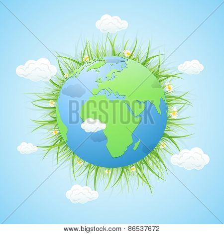 Earth With Grass And Clouds On Blue Background