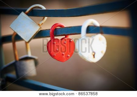 Red and White Love Lock as a symbol of relationship faithfulness