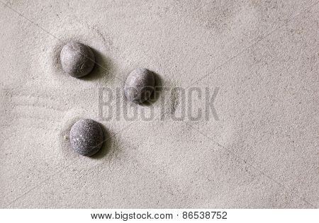 pattern of stones on the dry sand