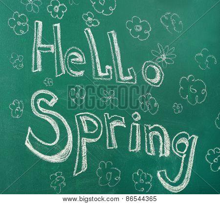 Hello spring written with chalk on blackboard