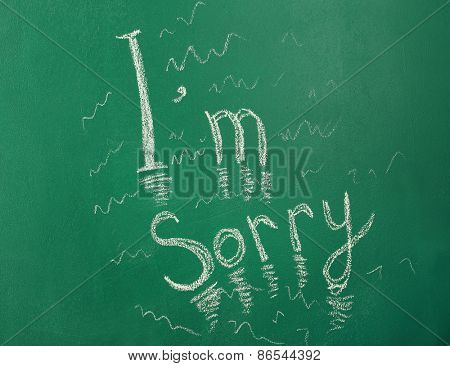 I am Sorry written with chalk on blackboard