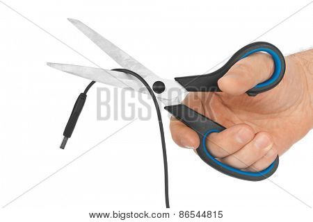 Hand with scissors and computer cable isolated on white background
