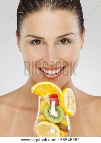 Young woman and fresh fruit