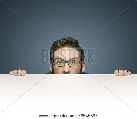Young businessman over table surface
