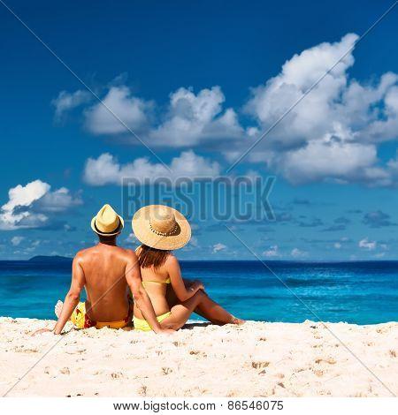 Couple on a tropical beach at Seychelles, La Digue
