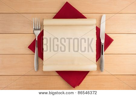 parchment and napkin on wooden background