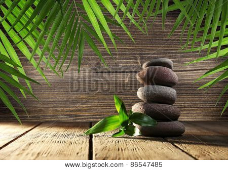 Spa stones and bamboo on wooden background