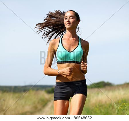 Happy young Woman Runner. Fitness Girl Running outdoors