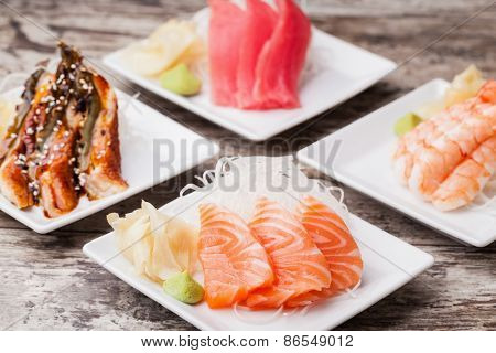 delicious mixed sashimi on a black plate