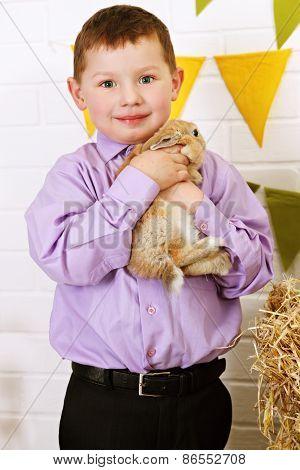 Boy Holding A Rabbit