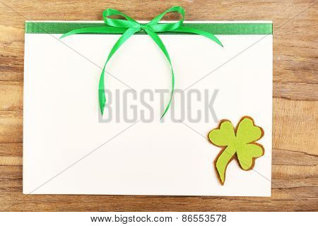 Greeting card for Saint Patrick's Day on wooden table background