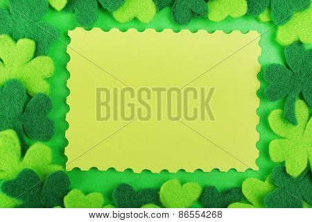 Greeting card for Saint Patrick's Day with shamrocks on green background