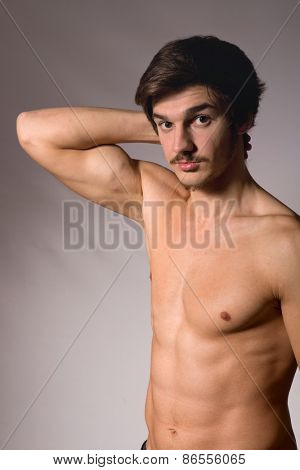 young casual man in topless, studio picture