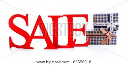 Sale with gifts isolated on white