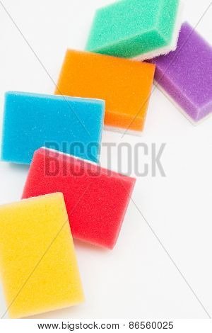 color sponges for washing dishes on white background