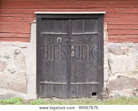 Wooden black doors on a warehouse.