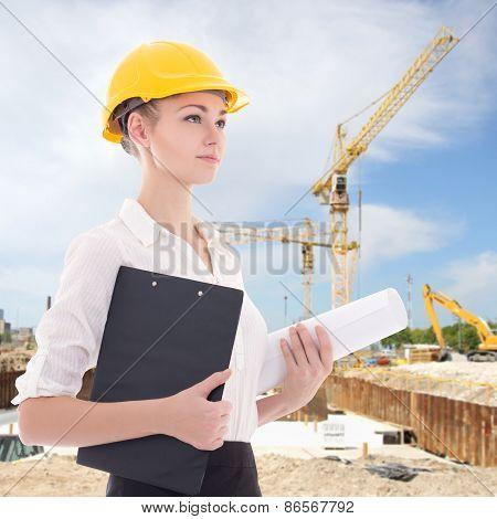 Beautiful Business Woman Architect In Yellow Builder Helmet