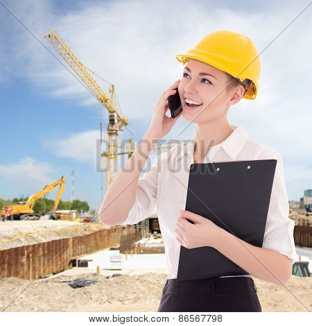 Beautiful Business Woman Architect In Builder Helmet Talking By Phone