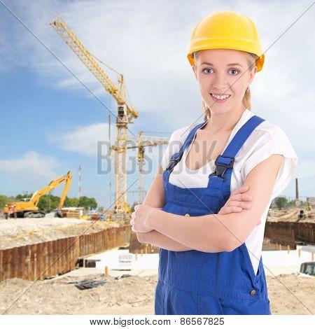 Young Beautiful Woman In Blue Builder Uniform