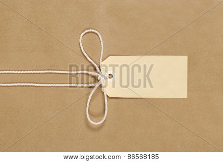 Brown Parcel With String And Label