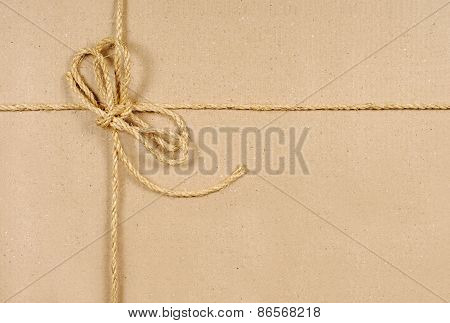 Brown Cardboard Box With String
