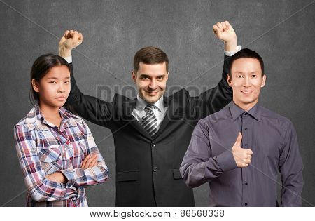 Team and happy businessman with hands up, celebrating his victory