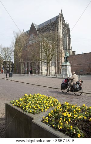 Yellow Flowers And Man On Bicycle Near Dom Church In Utrecht