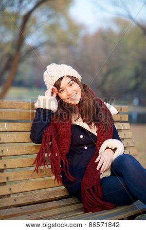 Girl Sitting On Bench In Park