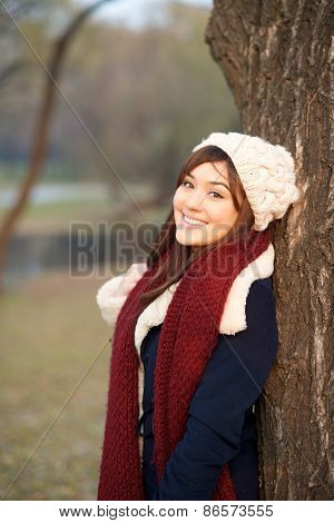 Beautiful Girl Leaning On A Tree