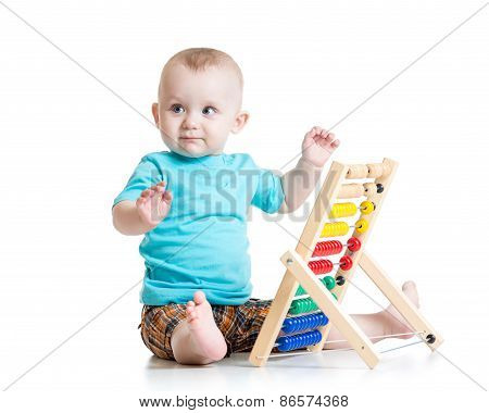baby playing with a colorful abacus