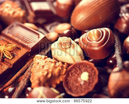 Chocolates background. Chocolate. Assortment of fine chocolates in white, dark, and milk chocolate. Variety of Praline Chocolate sweets