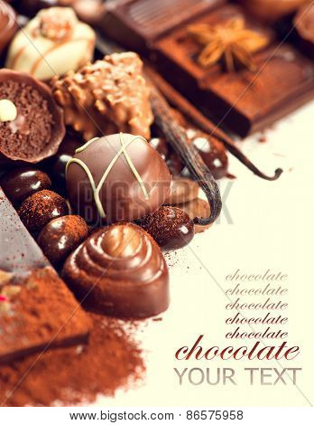 Chocolates border. Chocolate. Assortment of fine chocolates in white, dark, and milk chocolate. Variety of Praline Chocolate sweets