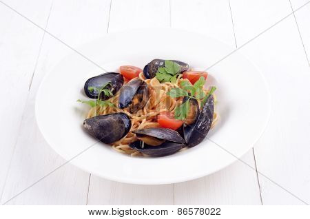 Spaghetti In Tomato Sauce With Mussels And Fresh Coriander