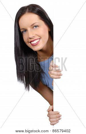 Friendly Girl Peeking Round A White Board