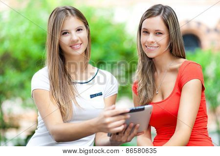Couple of students using a tablet