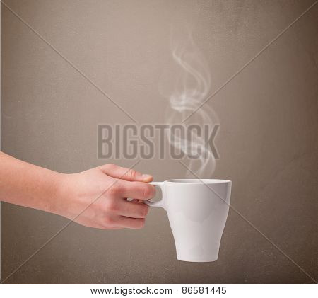 Coffee cup with abstract white steam, close up