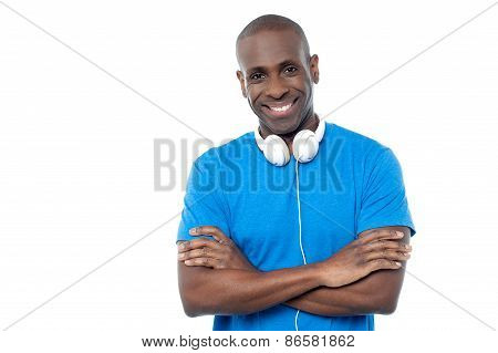 Smiling Young Guy Hanging Headphones In His Neck