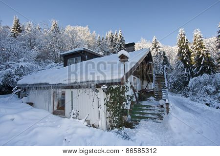 traditional farm under the snow, Vosges, France