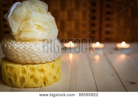Three sponges, candles on background
