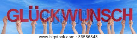 People Holding Straight German Word Glueckwunsch Means Congratulation Blue Sky
