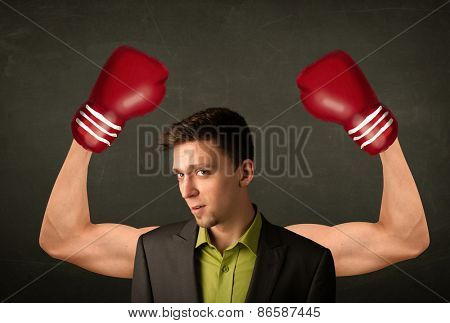 Handsome businessman with strong and muscled boxer arms concept