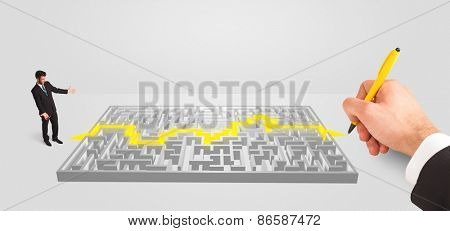 pensive businessman in front of labyrinth, maze solution concept
