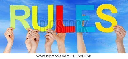 Many People Hands Holding Colorful Straight Word Rules Blue Sky