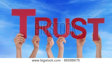 Many People Hands Holding Red Straight Word Trust Blue Sky