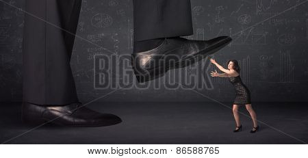 Huge leg stepping on a tiny businnesswoman concept on background