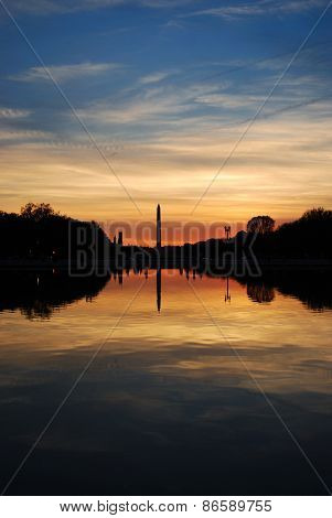 Washington monument sunset with lake reflection silhouette panorama, Washington DC