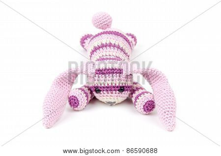 Sad Knitted Rabbit Toy Lays Isolated On White