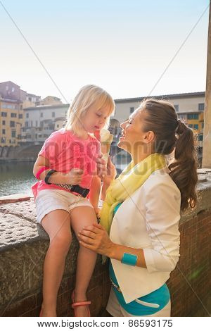 Mother And Baby Girl Eating Ice Cream Near Ponte Vecchio In Flor