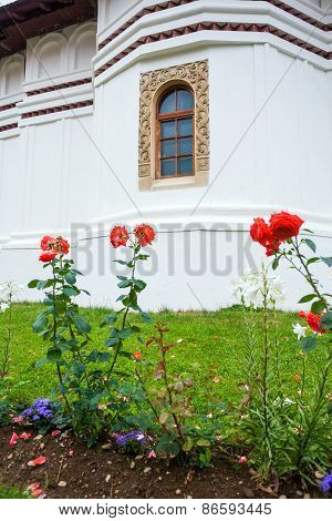 Flowers In Front Of Sambata De Sus Church Inside Monastery Courtyard In Transylvania